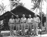 Headquarters of Commander, Air, South Pacific on Espiritu Santo, New Hebrides, 16 Jun 1943, with USMC MGen Ralph Mitchell, USMC MGen Holland Smith, Adm Chester Nimitz, VAdm Aubrey Fitch, and Adm William Halsey in front.