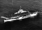 USS Bennington steaming out of San Diego, California en route Pearl Harbor, Hawaii with a deck load of aircraft, 1 Jan 1945.