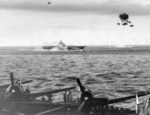 As seen from the USS Hornet (Essex-class) anti-aircraft shells burst above the USS Bennington southeast of Kyushu, Japan, 14 May 1945. Note Hornet's F6F Hellcats in the foreground.