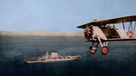 United States Navy Fighting Squadron 2-B Commander J.J. Clark flying a Boeing F-3B past the carrier USS Lexington (Lexington-class), circa 1931, probably along the California coast.