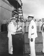 Admiral Chester Nimitz presenting the Navy Cross to Aviation Chief Machinist