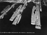 Piers at Puget Sound Navy Yard in Bremerton, Washington, United States with, left to right, repair ship (converted collier) Jason, and carriers Lexington (Lexington-class), Saratoga, 6 Aug 1932.