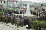 British and American troops join with residents of Courseulles-sur-Mer in Bastille Day ceremonies at the town's War Memorial. Courseulles-sur-Mer was the first town in Normandy to be liberated by the Allies.