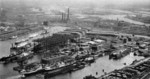 View of Howaldtswerke Kiel shipyard, Kiel, Germany, 1939; note slips, floating dry docks, equipping piers, and workshops; Schwentine River at right center