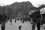 View of a street in Chongqing, China, late 1937; note newly constructed bunkers on the top of the hill
