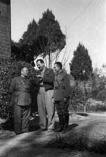 Harrison Forman with two Chinese officials, Changsha, Hunan Province, China, 1942, photo 1 of 2
