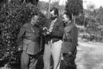 Harrison Forman with two Chinese officials, Changsha, Hunan Province, China, 1942, photo 2 of 2