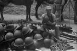 Chinese soldier with captured Japanese equipment, Hubei Province, China, 1942; note Type 96 machine gun and other unidentified equipment