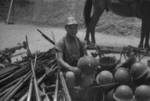 Chinese soldier with captured Japanese equipment, Hubei Province, China, 1942; note Arisaka Type 38 rifles, Type 96 machine gun, and other unidentified equipment