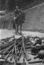 Mounted Chinese officer with captured Japanese equipment, Hubei Province, China, 1942, photo 1 of 2; note Arisaka Type 38 rifles, Type 96 machine gun, and other unidentified equipment