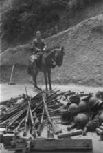 Mounted Chinese officer with captured Japanese equipment, Hubei Province, China, 1942, photo 2 of 2; note Arisaka Type 38 rifles, Type 96 machine gun, and other unidentified equipment
