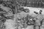 Captured Japanese clothing, Type 91 or Type 95 gas masks, helmets, and Type 11 machine gun, Changde, Hunan Province, China, 25 Dec 1943