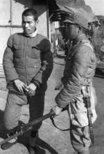 Chinese soldier with Hangyang Type 88 rifle guarding a Japanese prisoner of war, Changde, Hunan Province, China, 25 Dec 1943