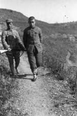 Chinese soldier with Hangyang type 88 rifle guarding a Japanese prisoner of war, Changde, Hunan Province, China, 25 Dec 1943, photo 1 of 2