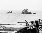 Twisted wreckage of the Victory-ship SS Quinault Victory after being demolished in a munitions explosion at Port Chicago, California, United States, 17 Jul 1944. 18 Jul 1944 photo.