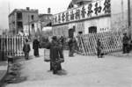 Civilians walking pasting a road block being readied in preparation of a possible Japanese invasion, Chongqing, China, fall of 1937