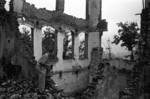 Harrison Forman in a ruined section of Chongqing, China, 1942, photo 3 of 4
