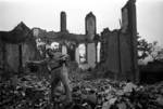 Harrison Forman in a ruined section of Chongqing, China, 1942, photo 4 of 4