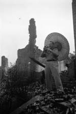 Harrison Forman in a ruined section of Chongqing, China, 1942, photo 1 of 4