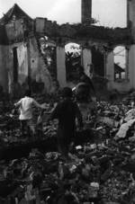 Children playing amongst destroyed buildings, Chongqing, China, 1941