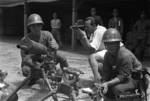 Harrison Forman filming Japanese naval infantrymen at Wusong, northern Shanghai, China, mid-1937; note captured Chinese Type 24 heavy machine gun and ZB vz. 26 machine guns