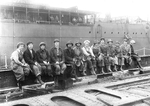 Thirteen women rivet heaters and passers at the Puget Sound Naval Shipyard, Bremerton, Washington, United States, 1919.