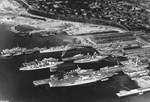 Aerial view of the piers and drydocks at the Puget Sound Naval Shipyard, Bremerton, Washington, United States, 1940.