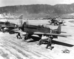 North American F-51D Mustang fighters of No. 2 Squadron of the South African Air Force at the Chinhae Air Base (now Jinhae), South Korea, 1 May 1951. Note wing-mounted HVAR air-to-surface rockets.