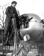 Two crew members loading ammunition for their A-26 bomber