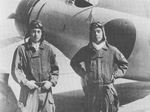 Japanese pilots Masao Asai and Masao Sato aboard carrier Akagi, 1938-1939; note A5M fighter in background