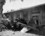 Wreckage of a Japanese A6M2 Zero fighter at Buliding 52 (Ordinance Machine Shop) at Fort Kamehameha, US Territory of Hawaii, 7 Dec 1941; the fighter was flown by Petty Officer 1st Class Takeshi Hirano