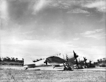 Captured A6M5 Model 52 Zero fighters and one Ki-46 reconnaissance aircraft at the RNZAF airfield at Jacquinot Bay, New Britain, 18 Sep 1945