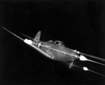P-39 Airacobra during a test flight with all weapons firing, 1941