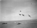 Albacore aircraft of No. 820 Squadron FAA flying in formation over HMS Formidable and other warships, 1940s