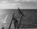 US Navy pilot Lt (jg) C. Clifton Francom unsuccessfully testing TBM Avenger torpedo bomber with experimental wing mounted radome aboard Ticonderoga, 4 Jul 1944, photo 2 of 5