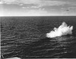 US Navy pilot Lt (jg) C. Clifton Francom unsuccessfully testing TBM Avenger torpedo bomber with experimental wing mounted radome aboard Ticonderoga, 4 Jul 1944, photo 3 of 5