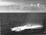 US Navy pilot Lt (jg) C. Clifton Francom unsuccessfully testing TBM Avenger torpedo bomber with experimental wing mounted radome aboard Ticonderoga, 4 Jul 1944, photo 4 of 5