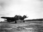 Beaufighter aircraft of No. 31 Squadron RAAF landing at an airfield on Tarakan Island off Borneo, 28 Jun 1945