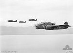 Four Beaufort bombers of No. 100 Squadron RAAF in flight near Wewak, New Guinea, 20 Jan 1945