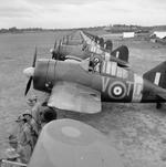 Buffalo Mark I fighters of No. 453 Squadron RAF at Sembawang, Singapore lined up in preparation of an inspection by Air Vice Marshal C. W. H. Pulford, Nov 1941
