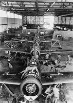 British mechanics assembling Buffalo fighters, Singapore, circa 12 Aug 1941