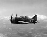 Lieutenant Commander Joseph C. Clifton in flight in a Buffalo fighter, 2 Aug 1942, photo 1 of 2