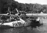 Australian troops of 37/52nd infantry battalion loading gear onto a New Zealand PB2B-1 Catalina aircraft at Nantambu, New Britain, Solomon Islands, 22 Aug 1945
