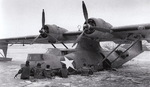 US Navy personnel freeing a PBY-5A Catalina aircraft from frozen waters in the Aleutian Islands at Kodiak Bay, US Territory of Alaska, May 1942-Jan 1943
