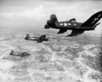 FG-1D Corsair fighters of US Marine Corps squadron VMF-323 in flight over Okinawa, Japan, 10 Jun 1945