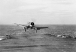 Corsair Mk II fighter of British No. 1833 Naval Air Squadron landing aboard HMS Illustrious, Dec 1943