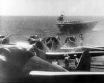 D3A1 dive bombers preparing to take off from Akagi to attack Pearl Harbor, US Territory of Hawaii, 7 Dec 1941; carrier Soryu in background