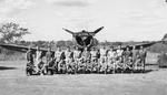 Aerial gunners of 3rd Bomb Group, US 8th Bomb Squadron (Light) pose with an A-24 Banshee aircraft at Charters Towers, Australia, Jan-Mar 1942