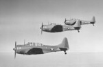 Three Douglas A-24 Banshee aircraft flying in formation, 1941-42