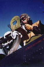 A USS Independence radioman-gunner posing at his post on a Dauntless dive bomber, 30 Apr 1943